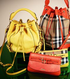 Add a splash of colour with vibrant Burberry leather and check bags
