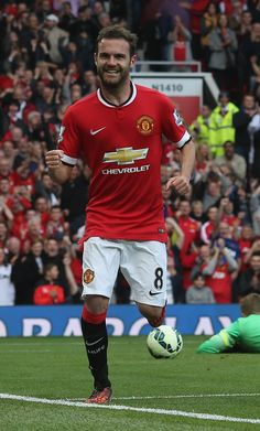 @manutd no.8 Juan Mata celebrates in front of the Stretford End after scoring the fourth goal in the Reds' 4-0 win over QPR at Old Trafford.