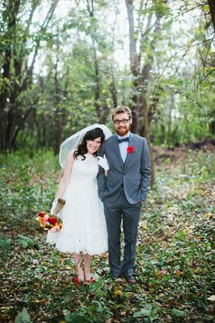 """how adorable are these two?  from """"Minnesota Lodge Wedding""""   Wedding Flowers: Jackie of Just Bloomed / Bride's Reception Dress: Priscilla of Boston, """"Trish"""" / Bride's Gloves: Vintage /   Groom's Suit: Ben Sherman / Groom's Bow Tie: Pierrepont Hicks"""