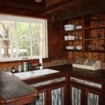 Ellinger tiny house kitchen with dark wood