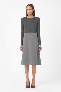 Made from ribbed wool with a slight stretch, this dress has a contrast woven wool-mix skirt for a simple contrast of textures. Closely fitted on the top, it is a flared A-line shape with neat long sleeves, a round neckline and a metal back zip fastening.