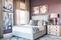 A beautiful violet color on the walls and ceiling creates a deluxe backdrop for this soothing terrace bedroom that enjoys direct access to the covered patio outside.