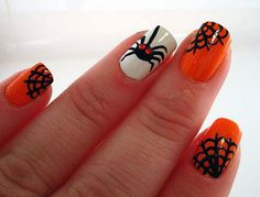 Spiders and cobwebs inspired Halloween nail art. Use white, orange and black polishes to create the spider and cobweb details on your nails. You can use the orange and white polishes alternately as base colors.