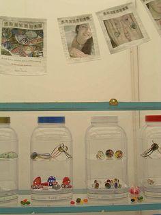 Plastic jars transformed into tiny curio cabinets. {craft booth setup}