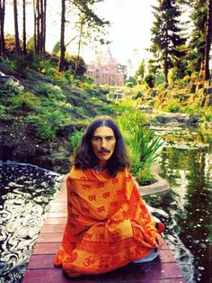 George Harrison in his garden at Friar Park. He spent most of his time working here in his later years.