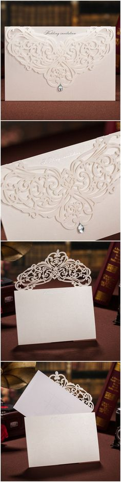 all white elegant laser cut wedding invitations with rhinestone. i'd slip a clear piece of lightly scented lace printed paper in the envelope over the invitation) as well. Wedding Invitation Envelopes, Laser Cut Wedding Invitations, Wedding Stationary, Invitation Ideas, Wedding Cards, Our Wedding, Dream Wedding, Spring Wedding, Elegant Wedding