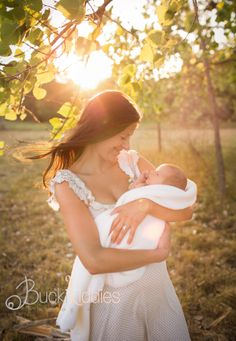 outdoor newborn with mom at sunset