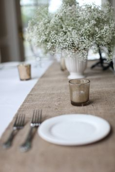 Burlap table runner by The Ruffled Daisy Even the simplest touches can be striking. Take a look at these 20 ideas for wedding table decorations.