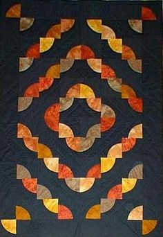 Drunkard Path blocks. love the colours on this quilt