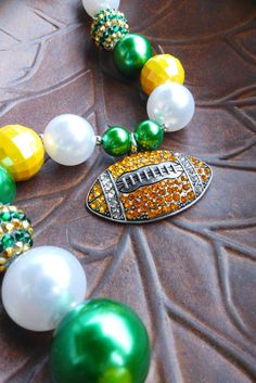 Show your team spirit by wearing this University of Oregon Ducks or Green Bay Packers-inspired green and yellow bubblegum-bead bracelet. They