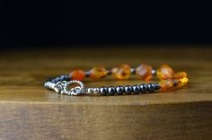 Amber Bracelet with Hematite by LittleBitCrazy on Etsy