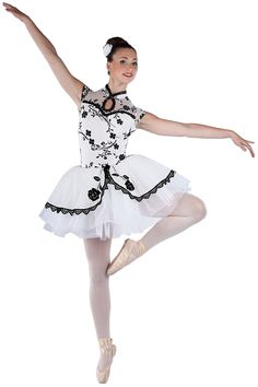 15444 Winter Blossom | Ballet Pointe Dance Costumes | Dansco 2015 | White spandex leotard with black flocked white mesh overlay, front keyhole and attached glitter mesh top skirt. Separate white chiffon tutu. Black sequin braid, rose applique and lace trim. Headpiece included.