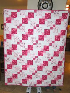 Made this cute quilt and matching pillows for the couch. Love the pattern, a darker color (instead of the white with pink hearts) would ha. Batik Quilts, Lap Quilts, Strip Quilts, Quilt Blocks, Disappearing Nine Patch, Nine Patch Quilt, Pinwheel Quilt, Cute Quilts, Quilting Projects