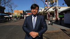 Tim Soutphommasane near the Freedom Gate in Cabramatta, a suburb he has seen throw off negative racial stereotypes