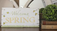 Greet the new season with this Welcome Spring sign made from an old board and a DIY stencil made with adhesive vinyl and transfer tape.