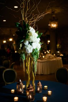 Tall twisted willow, simple white hydrangeas and tealights