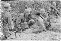Viet Cong Soldier | Vietnam War Picture: Soldiers Surrounding a Captured Viet Cong