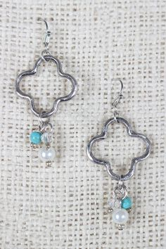 "These cute earrings feature oxidized silver finish, a quatrefoil charm, a cluster of multicolored beads and a french hook back. Measurement Earrings measure approx. 2.25"" L x 1"" W."