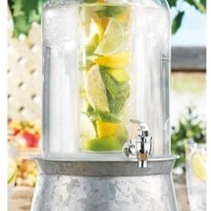 Home Essentials - Cylinder Glass Drink Dispenser with Infuser - If you crave the refreshing taste of fruit infused water or lemonade, the cylinder glass drink dispenser will be the perfect drinking vessel! Our high quality drink dispenser features a charming vintage look and is composed of clear glass to easily view the available beverage. With this nostalgic piece, you can easily turn backyard barbecues, picnics, and dinner parties into long-lasting memories. Its attractive galvanized metal…
