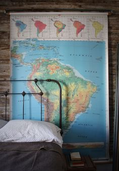 second bedroom. strip paint from victorian iron bed, repurpose hanging wall / school map.