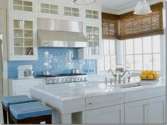 white cabinets, glass doors, marble countertops, blue tile backsplash - add more modern shapes and rustic textures, maybe sea glass or green tiles and we have a winner...