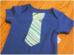 little onesie with ties sewn on them!    sooo cute!  and everyone I know is having or has had boys!  I will have to get on it!  :)