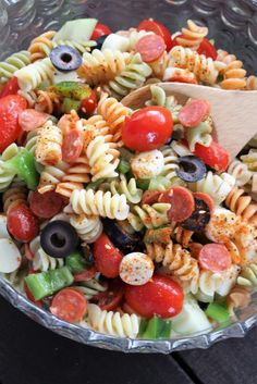 This pasta salad will be a hit at any potluck. The mozzarella cheese and the pepperonis mixed with fresh vegetables and pasta are always a big hit.
