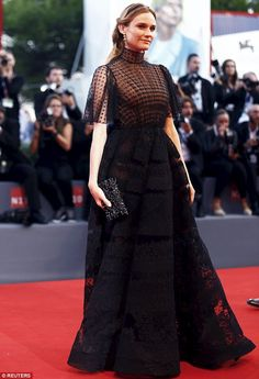Gothic and gorgeous:The 39-year-old stunner wore a dramatic black dress for the event, wh...