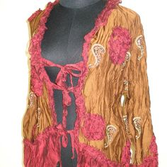 gorgeous  tan embroidered silk jacket with burgundy shot chiffon ruffles.... $85.00, via Etsy.