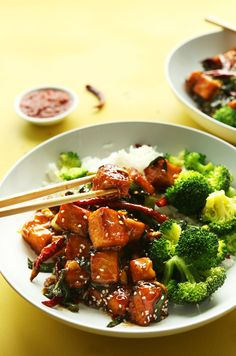 Grabbing a piece of spicy, sweet gluten-free General Tso's Tofu