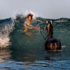 Going out in the ocean to exercise his horse and got caught in an unexpected wave.  Hope the horse didn't flip out