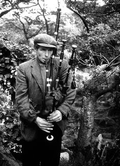 Old photograph of a travelling Piper in Highland Perthshire, Scotland