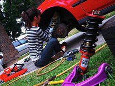 Girl working on car