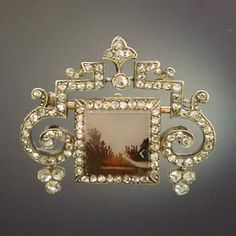 1900 Faberge brooch with 105 rose cut diamonds in a decorative mounting in the so called silver on gold technique, set with many rose cut diamonds and in the center a flat, square cut piece of moss agate looking like a pretty landscape.