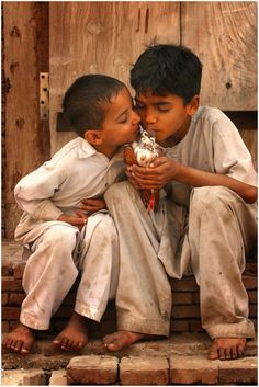 Kids Kissing a Pigeon in Pakistan / Photography by Umair Ghani #world #cultures