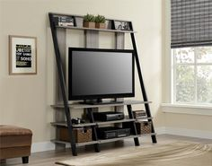 Clean, modern and attractive, this Zipcode™ Design Russel TV Entertainment Center makes a big impact in any décor. The ladder-style home entertainment center is designed to accommodate flat-panel TVs. The leaning-style shelves create a stunning focal point in your living room.
