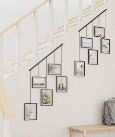 Display your favorite photos in an eye-catching fashion using the new Exhibit Photo Display. Exhibit features five hanging, gallery-style… Decorating Stairway Walls, Staircase Wall Decor, Stair Walls, Stair Decor, Stair Photo Walls, Decorating Tall Walls, Hallway Wall Decor, Photo Decoration On Wall, Diy Wall Decorations
