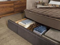 Solution: Take advantage of the space under your bed by using storage boxes or slide-out bins for seasonal items, or choosing a bed with built-in drawers to hold the overflow from your closet.