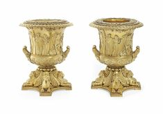 A PAIR OF GEORGE III SILVER-GILT WINE-COOLERS, COLLARS AND LINERS MARK OF BENJAMIN AND JAMES SMITH, LONDON, 1810, RETAILED BY RUNDELL, BRIDGE AND RUNDELL.