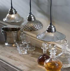 Mercury Light Pendants eclectic pendant lighting. Mercury glass has a great visual gray texture to it. Love these mixed styles.
