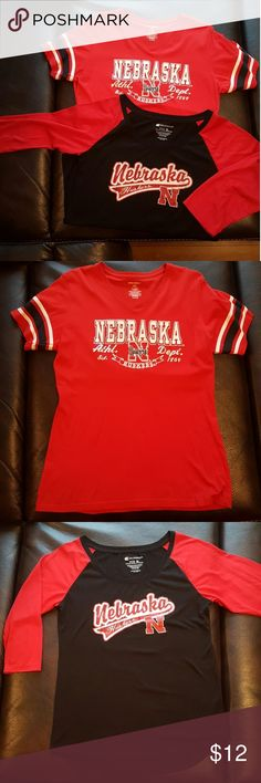 Pair of Nebraska Husker Shirts Top Shirt: Size XL ProEdge shirt with silver foil lining the letters!   Bottom Shirt: Size XL Colosseum shirt with 3/4 length sleeves!  Both shirts run a little smaller and each only worn once!! Colosseum Tops Tees - Short Sleeve