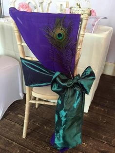 Stunning purple chiffon sash, tied horizontally with a hunters green taffeta sash, then finished with an elegant peacock feather.   Want your own quote? Then email me with your ideas! hello@beckiemelvinevents.co.uk  More styles can be seen at www.beckiemelvinevents.co.uk