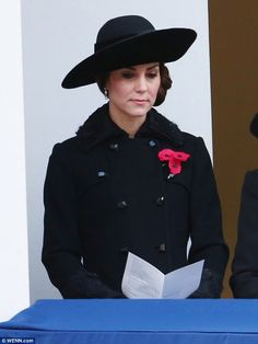 The Duchess of Cambridge, 34, matched her outfit to the mood on Remembrance Sunday as she dressed in a black Diane von Furstenberg coat to remember the fallenat the Cenotaph