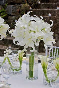 white lilies in tall cube vases with arum (calla) lilies - table centrepiece - David Tutera - Tropical White Event