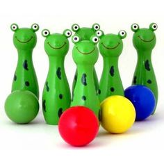Bowling frogs is a great toy for your child it's bright colours and happy frog faces make it hard to ignore. This is a toy that your children love to play with and they can spend hours setting up the frogs and bowling them down. Wooden Calendar, Problem Set, Push Toys, Painted Cups, Wooden Train, Kids Hands, Toys Online, Niece And Nephew, Toys Shop
