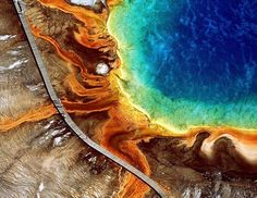 """If you look closely, you can see tourists meandering the boardwalk at the edge of the Grand Prismatic Spring in Yellowstone National Park, in Wyoming. The image is part of a photo exhibit and coffee table book called """"Earth From Above"""" by Paris-born naturalist, author and photographer Yann Arthus-Bertrand.  (Yann Arthus-Bertrand, Harry N. Abrams, Inc./AP Photo)"""