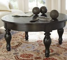 Round coffee tables; unexpected shape for something traditional. Love. Hayden Round Coffee Table from PB.
