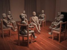In the room of dream/dread, I abrupt awake clapping, 2001 Installation view, Jane Hartsook Gallery, 2001 Eight life-size ceramic figures on wood chairs, dimensions variable