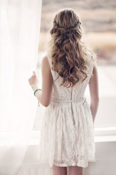 Cream lace dress with pulled back flowing wavy hair