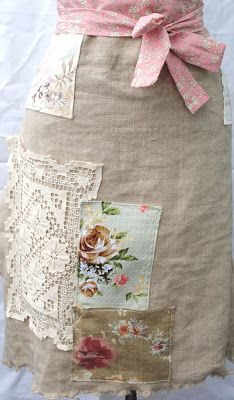 Linen or rough texture flax-colored fabric, a few snip-its from vintage florals and lace.